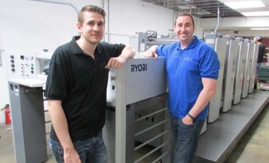 (From left) Kyl and Ty Blankenship. The brothers' father, Franko, founded the print firm in 1983.